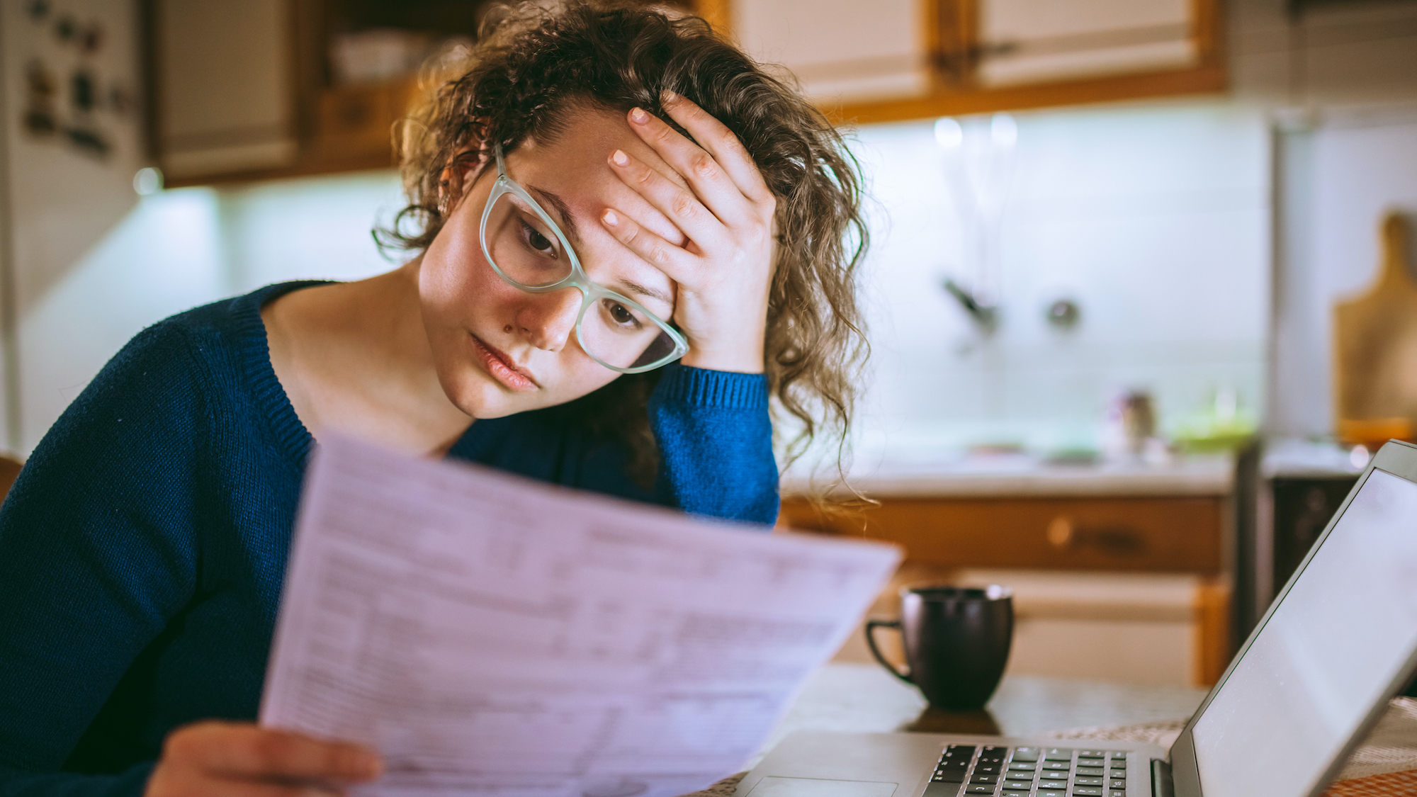 Woman looking at financial papers