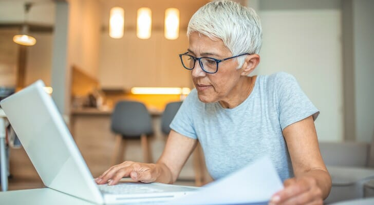Senior citizen prepares her tax returns